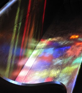 Stained glass light on pew
